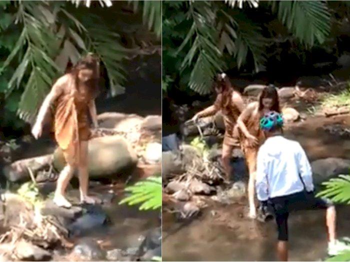 viral-video-pesepeda-ketemu-wanita-cantik-di-sungai-asyik-mandi-hanya-ditutupi-jarik_700